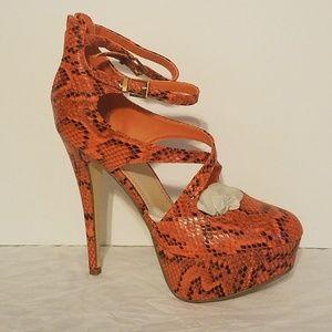 Orange snakeskin platform stiletto heels buckle